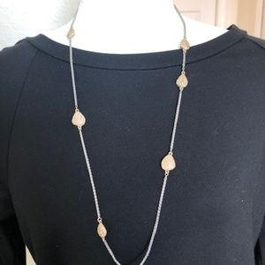 Silver tone necklace with gold accents